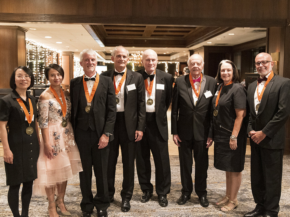 group of academy of alumni dressed up